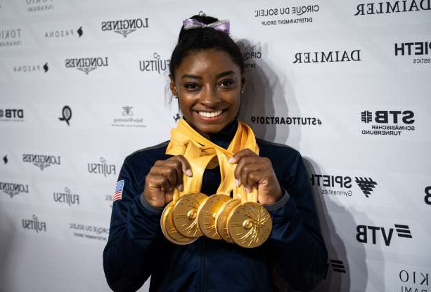 Slide 24 of 30: Simone Biles of USA poses with her five gold medals in the mixed zone after the women's Apparatus Final at the FIG Artistic Gymnastics World Championships in Stuttgart, Germany, 13 October 2019.