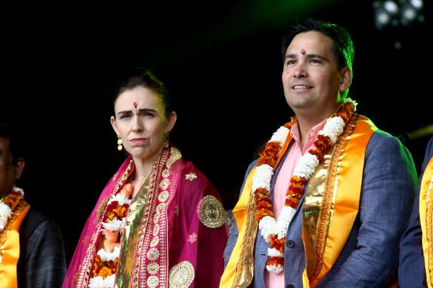Slide 25 of 30: AUCKLAND, NEW ZEALAND - OCTOBER 12: New Zealand Prime Minister Jacinda Ardern (R) and National Party leader Simon Bridges pictured on stage during the 18th Auckland Diwali Festival on October 12, 2019 in Auckland, New Zealand. Auckland Diwali Festival is one of Auckland's biggest and most colourful cultural festival, celebrating traditional and contemporary Indian culture. (Photo by Phil Walter/Getty Images)
