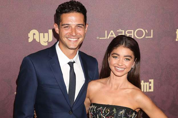 Slide 25 of 60: LOS ANGELES, CA - SEPTEMBER 15: Sarah Hyland and Wells Adams attend FIJI Water at Entertainment Weekly Pre-Emmy Party on September 15, 2018 in Los Angeles, California. (Photo by Jesse Grant/Getty Images for FIJI Water )