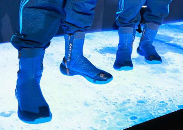 a person standing in front of a blue and white shoes: I'm guessing these boots could fetch a pretty penny if they were released to the retail market.