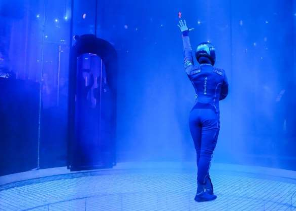 a person standing on a stage: Inside the tube a new dancer wearing the spacesuit was revealed.
