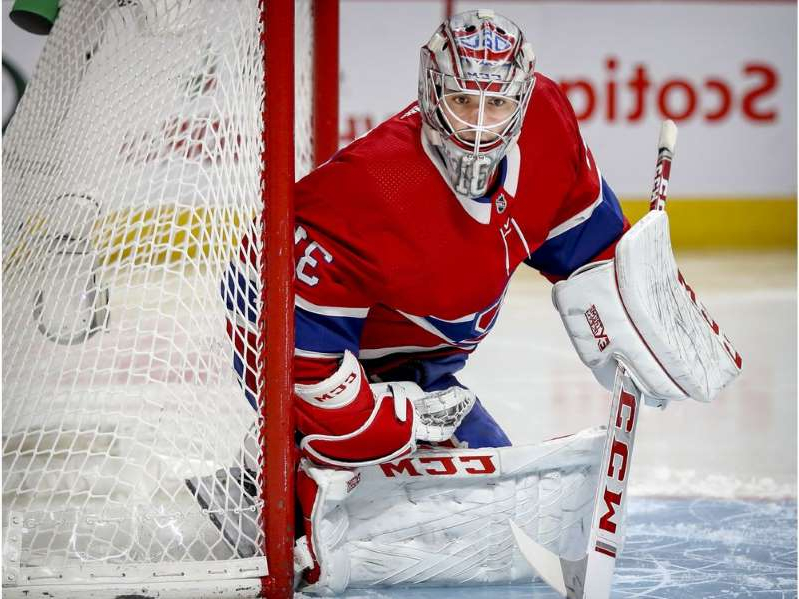 a snow skier in a red shirt: Montreal Canadiens' Carey Price tracks the puck during second period against the Boston Bruins at the Bell Centre in Montreal on Dec. 17, 2018.