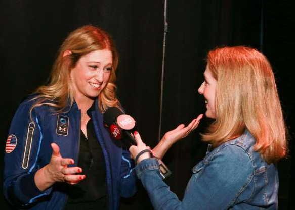 a woman holding a cell phone: Bridget Carey got to interview Beth Moses after the show.