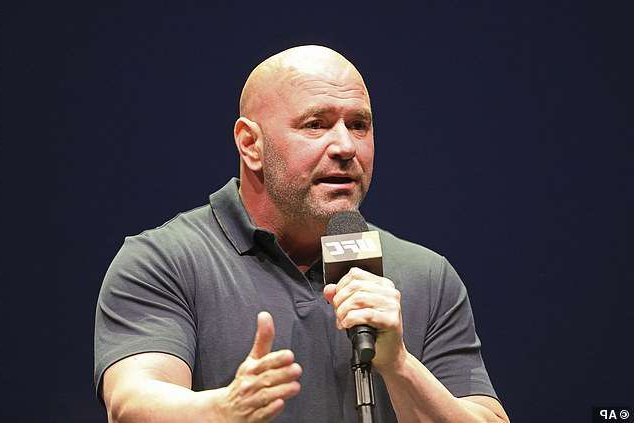 Dana White holding a microphone: White is keen to get McGregor back in the octagon, but it will not be until next year