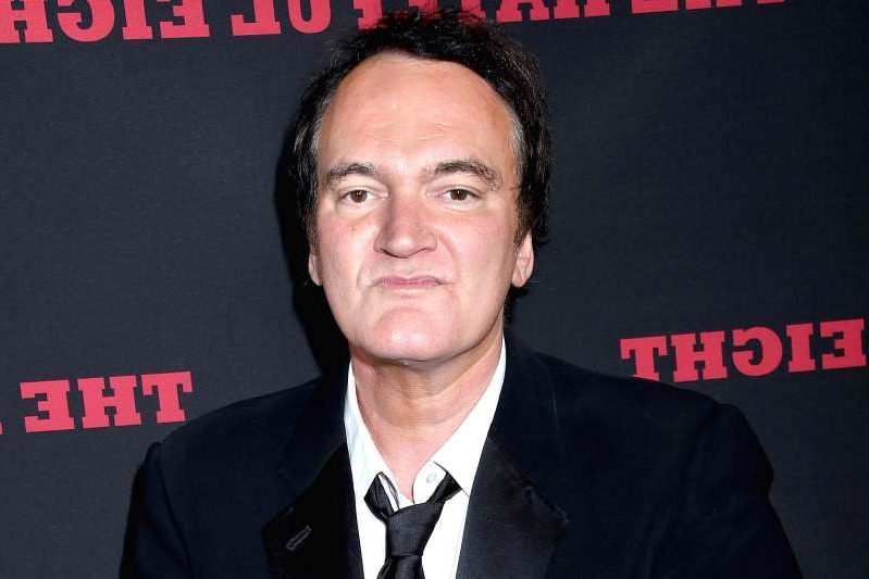 Quentin Tarantino wearing a suit and tie