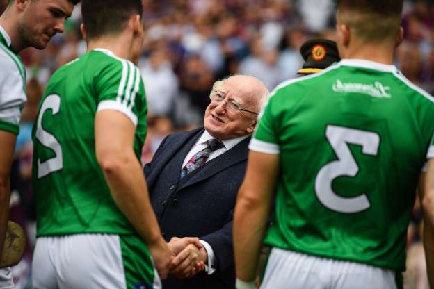 Slide 1 of 31: Dublin , Ireland - 19 August 2018; The President of Ireland, Michael D Higgins shakes hands with Seán Finn of Limerick prior to the GAA Hurling All-Ireland Senior Championship Final match between Galway and Limerick at Croke Park in Dublin. (Photo By Stephen McCarthy/Sportsfile via Getty Images)