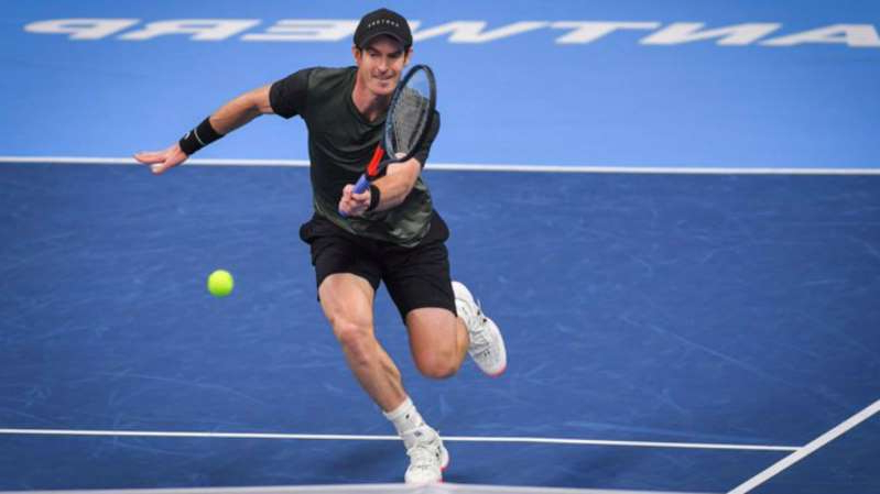 a man swinging a racket at a ball: Former world number one Andy Murray