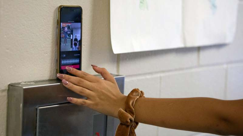Kate Sandoval, the founder of her school's TikTok club, sets up her iPhone to record a video.