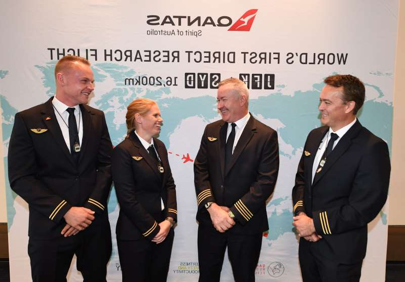 NEW YORK, NY - OCTOBER 17: (left to right) Qantas flight crew First Officer Jeremy Sutherland, Captain Sean Golding and second officers Lauren Drysdale and Jason MacDonald on October 17, 2019 in New York City. Qantas is the first commercial airline to ever fly direct from New York to Sydney and the 19-hour flight taking off on October 18, 2019 from New York's JFK airport is restricted to 50 people including crew to increase aircraft range, and will include medical scientists and health experts on board to conduct studies in the cockpit and the cabin to help determine strategies to promote long haul inflight health and wellbeing on ultra-long haul flights. It comes as the national carrier continues to work towards the final frontier of global aviation by launching non-stop commercial flights between the US and the UK to the east coast of Australia in an ambitious project dubbed