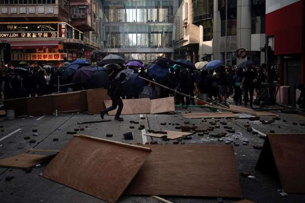 Protestors set up barricades to stop police in Hong Kong, Sunday, Oct. 20, 2019. Hong Kong protesters again flooded streets on Sunday, ignoring a police ban on the rally and demanding the government meet their demands for accountability and political rights.