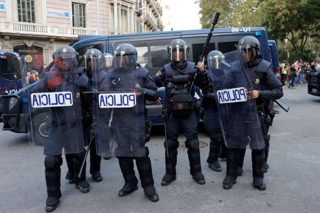Riot police get ready in Barcelona, Spain, Saturday, Oct. 19, 2019. Barcelona and the rest of the restive Spanish region of Catalonia are reeling from five straight days of violent protests for the sentencing of 12 separatist leaders to lengthy prison sentences.The riots have broken out at nightfall following huge peaceful protests each day since Monday's Supreme Court verdict. (AP Photo/Manu Fernandez)