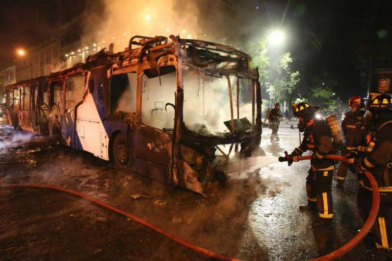 Week-long protests over a subway fare hike in Chile turned violent, with buses and train stations set alight.