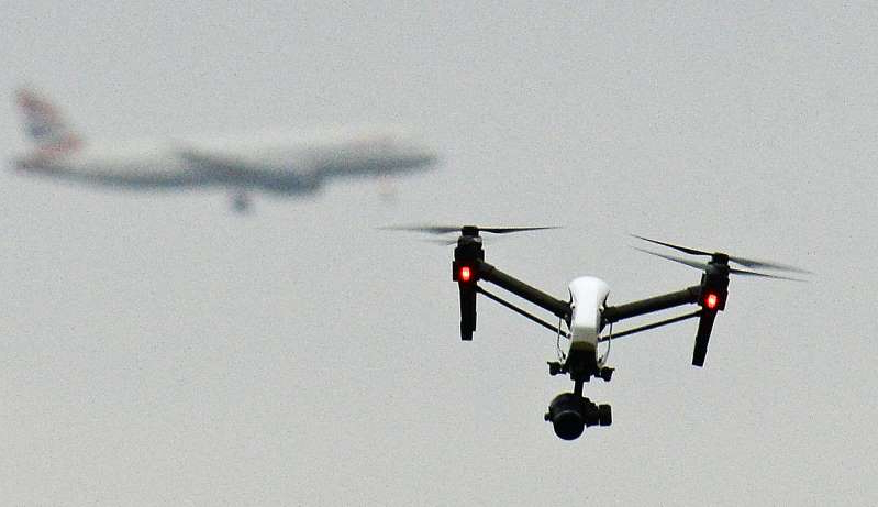 a airplane that is flying in the sky: The Government is seeking to crack down on the malicious use of drones (PA)