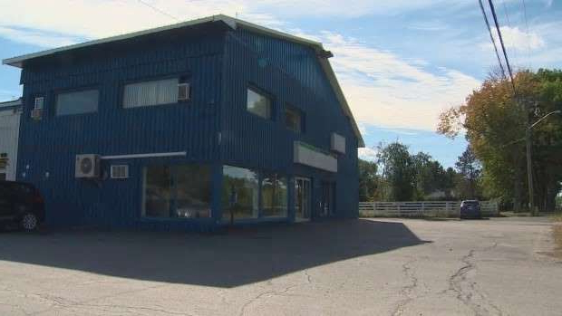 a building with a store on the side of a road: W&P Auto Sales is closed. Fredericton Police say they are investigating allegations of fraud involving the company.