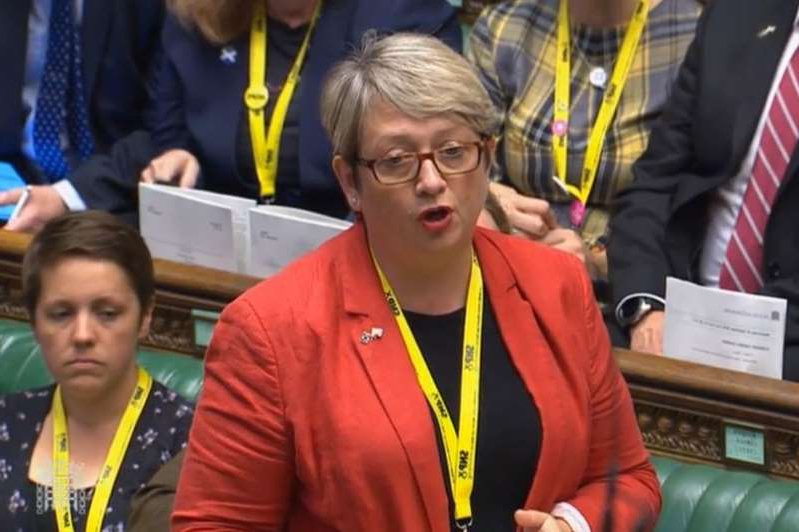 a group of people standing next to a person in a yellow shirt: SNP MP Joanna Cherry QC was one of the petitioners