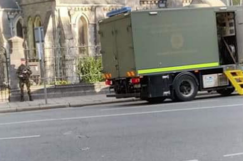 a large truck on a city street: The army bomb squad has arrived at the scene in Christchurch, Dublin