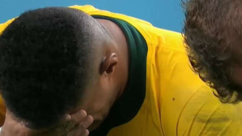 a man in a yellow shirt: The Wallabies were knocked out of the Rugby World Cup after being smashed by England.