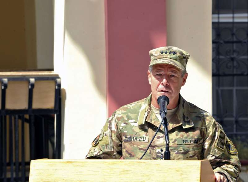 "a man wearing a uniform: In this Sept. 2, 2018, photo provided by the U.S. Air Force, Army Gen. Austin ""Scott"" Miller, commander of U.S. and NATO troops in Afghanistan, delivers remarks during a Resolute Support mission change of command ceremony in Kabul, Afghanistan. (U.S. Air Force/Tech. Sgt. Sharida Jackson/AP)"