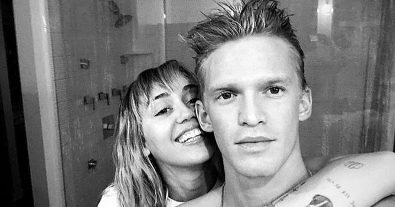 Cody Simpson standing in front of a mirror posing for the camera: Miley Cyrus Says She's on 'Vocal Rest' After Hospitalization as Romance with Cody Simpson Heats Up