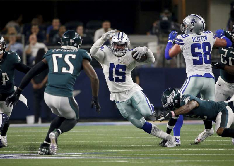 Dallas Cowboys tight end Jason Witten (82) blocks for running back Ezekiel Elliott (21) as Philadelphia Eagles strong safety Malcolm Jenkins (27) attempts to make the stop in the first half of an NFL football game in Arlington, Texas, Sunday, Oct. 20, 2019. (AP Photo/Ron Jenkins)