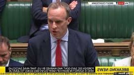 Dominic Raab wearing a suit and tie