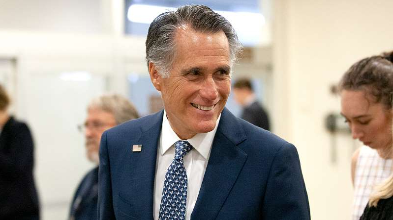 Mitt Romney wearing a suit and tie: Romney appears to confirm name of secret Twitter account