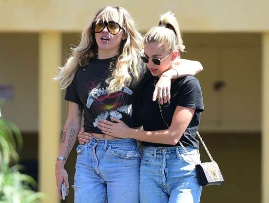 Slide 12 of 14: CAPTION: LOS ANGELES, CA - SEPTEMBER 14: Miley Cyrus and Kaitlyn Carter are seen on September 14, 2019 at Los Angeles. (Photo by Chris Wolf/Star Max/GC Images)