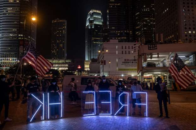 Slide 15 of 50: Protesters are seen holding up Free HK light signs during an anti-government Protest in Hong Kong, China, October 19, 2019. Pro-democracy Protesters have been taking to the streets in Hong Kong for months of the Government. (Photo by Vernon Yuen/NurPhoto via Getty Images)