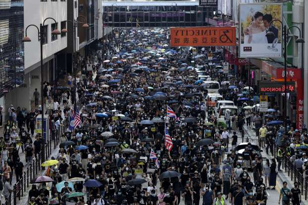 Slide 3 of 50: Thousands of protesters march during a rally in Hong Kong, Sunday, Oct. 20, 2019. Hong Kong protesters again flooded streets on Sunday, ignoring a police ban on the rally and demanding the government meet their demands for accountability and political rights. (AP Photo/Mark Schiefelbein)