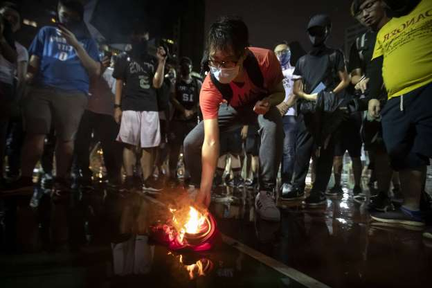 Slide 32 of 50: Demonstrators set a Lebron James jersey on fire during a rally at the Southorn Playground in Hong Kong, Tuesday, Oct. 15, 2019. Protesters in Hong Kong have thrown basketballs at a photo of LeBron James and chanted their anger about comments the Los Angeles Lakers star made about free speech during a rally in support of NBA commissioner Adam Silver and Houston Rockets general manager Daryl Morey, whose tweet in support of the Hong Kong protests touched off a firestorm of controversy in China.
