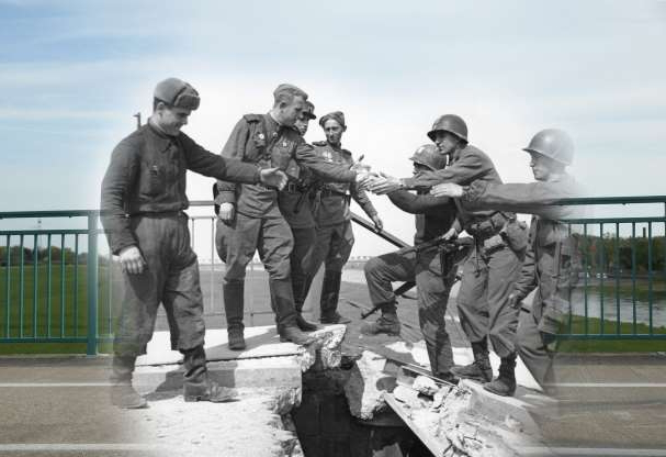 Slide 4 of 24: COMPOSITE: In this digital composite image a comparison has been made showing U.S. (L) and Soviet troops greeting one another on a damaged bridge over the Elbe River towards the end of World War II on April 26, 1945 in Torgau, Germany (Photo by Allan Jackson/Getty Images) and a view on the same bridge from the same perspective on April 29, 2015 in Torgau, Germany. (Photo by Sean Gallup/Getty Images) *** ARCHIVE BLACK AND WHITE *** TORGAU, GERMANY - 1945: US troops of the 69th Infantry Division (left), shake hands with Russian troops in a staged photo on the wrecked bridge over the Elbe at Torgau, Germany, to mark the previous day's link-up between American and Soviet forces, 26th April 1945. Among the Americans are Bernard E. Kirschenbaum and Richard Johnson (second and third from left, respectively). The Soviet soldier in the centre is Lt. Charles Thau, a Pole drafted into the Soviet Army in 1943. (Photo by Allan Jackson/Getty Images)*** MODERN DAY COLOR *** TORGAU, GERMANY - APRIL 29, 2015: The Elbe River flows under a bridge at the site where U.S. troops coming from the west and Soviet Ukrainian troops coming from the east first met up towards the end of World War II on April 29, 2015 in Torgau, Germany. Europe, Russia and the former Allied powers will commemorate the 70th anniversary of the end of World War II and the victory over Nazi Germany on May 8-9. (Photo by Sean Gallup/Getty Images)