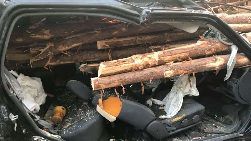 a car parked on a grill: The driver managed to survive. Pic: Whitfield County Fire