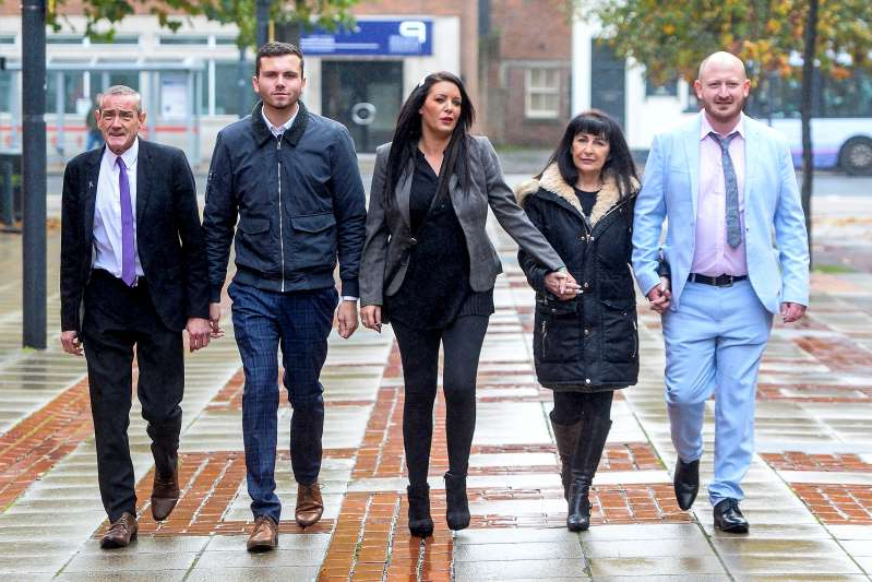 a group of people posing for the camera: From left, Jordan Plain, 25, Christine James-Roberts, 43, Kelly Meadows, 39, Jordan McDonald, 18 and Dean Walls, 51, all members of a paedophile hunting group arrive at Leeds Crown Court. (SWNS)