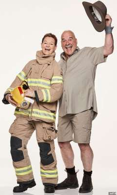 a man holding a pair of people posing for the camera: Daring duo! South Australian farmer Chris (left) and his firefighter partner Adrienne (right) are also ready for the challenge