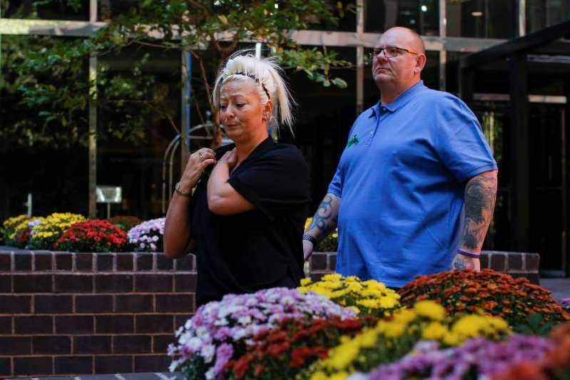Charlotte Charles and Tim Dunn, parents of British teen Harry Dunn who was killed in a car crash on his motorcycle, allegedly by the wife of an American diplomat, walk out after an interview in the Manhattan borough of New York City, New York, U.S., October 15, 2019. REUTERS/Eduardo Munoz