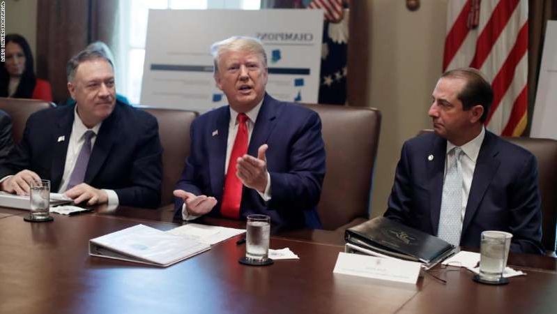 Donald Trump, Mike Pompeo sitting at a table: President Donald Trump speaks during a Cabinet meeting in the Cabinet Room of the White House, Monday, October 21.