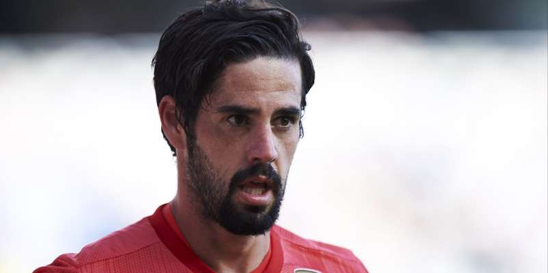 Isco wearing a red shirt looking at the camera: Football Gossip - Daily Round-Up