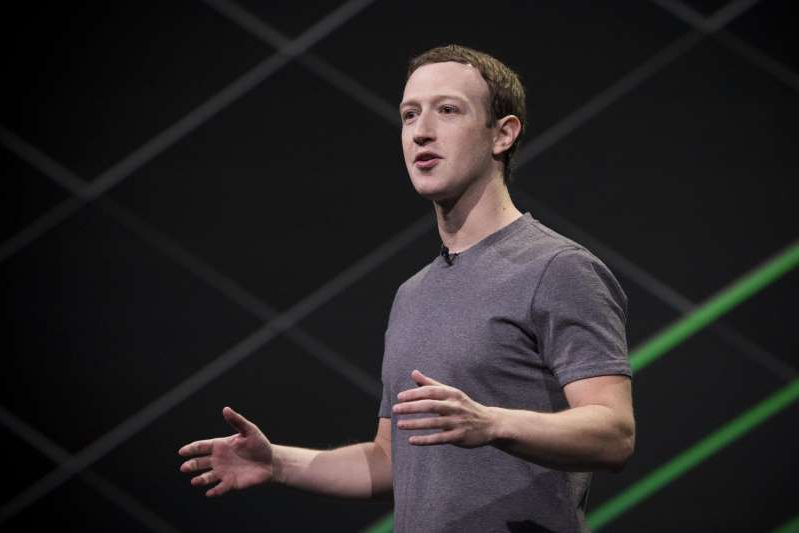 Mark Zuckerberg holding a racket: Facebook CEO Mark Zuckerberg says he needs to work on being a better communicator for his company.
