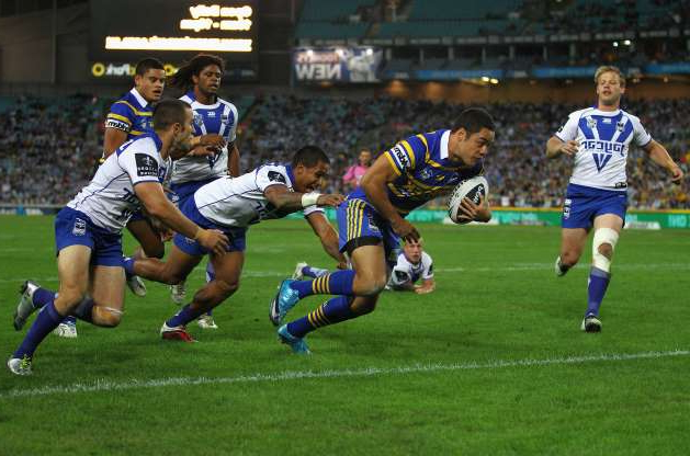 Slide 7 of 31: Jarryd Hayne of the Eels scores a try during the round six NRL match between the Parramatta Eels and the Canterbury-Bankstown Bulldogs at ANZ Stadium on April 15, 2011 in Sydney, Australia