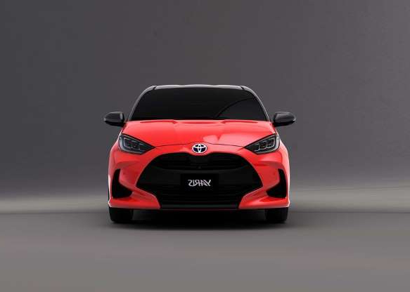 a black and red car: Like other Toyotas, the Yaris has LOTS of grille.
