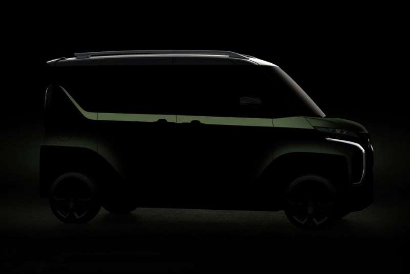 a car parked in a dark room: Mitsubishi