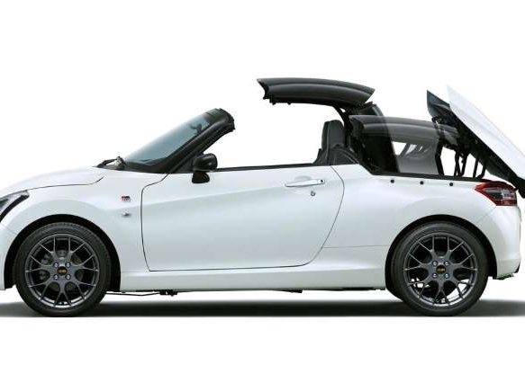 a car parked in a parking lot: The Copen GR Sport features a retractable hard top.