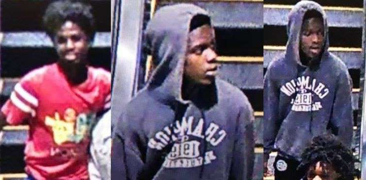 a group of people standing next to a man: Three men accused of robbing a victim outside South Park Mall are being sought.