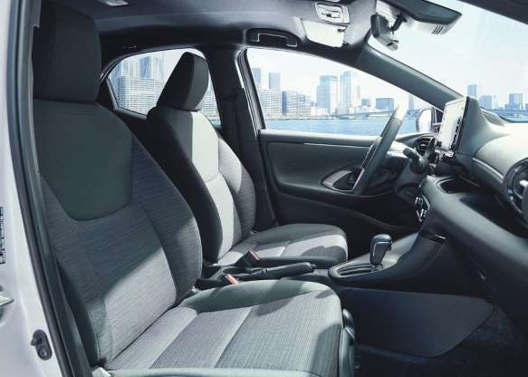 a passenger seat of a car: The front bucket seats can swivel and tilt for easier ingress and egress.