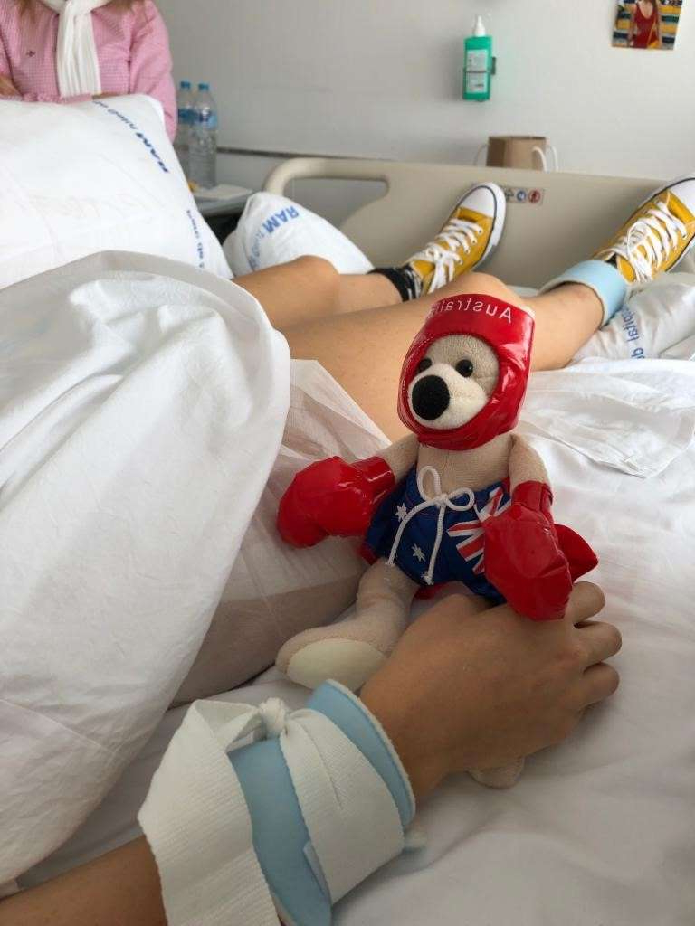 a red stuffed animal lying on the bed: Caroline Breure moved to Sydney five years ago, but is now in hospital in Barcelona after the accident.