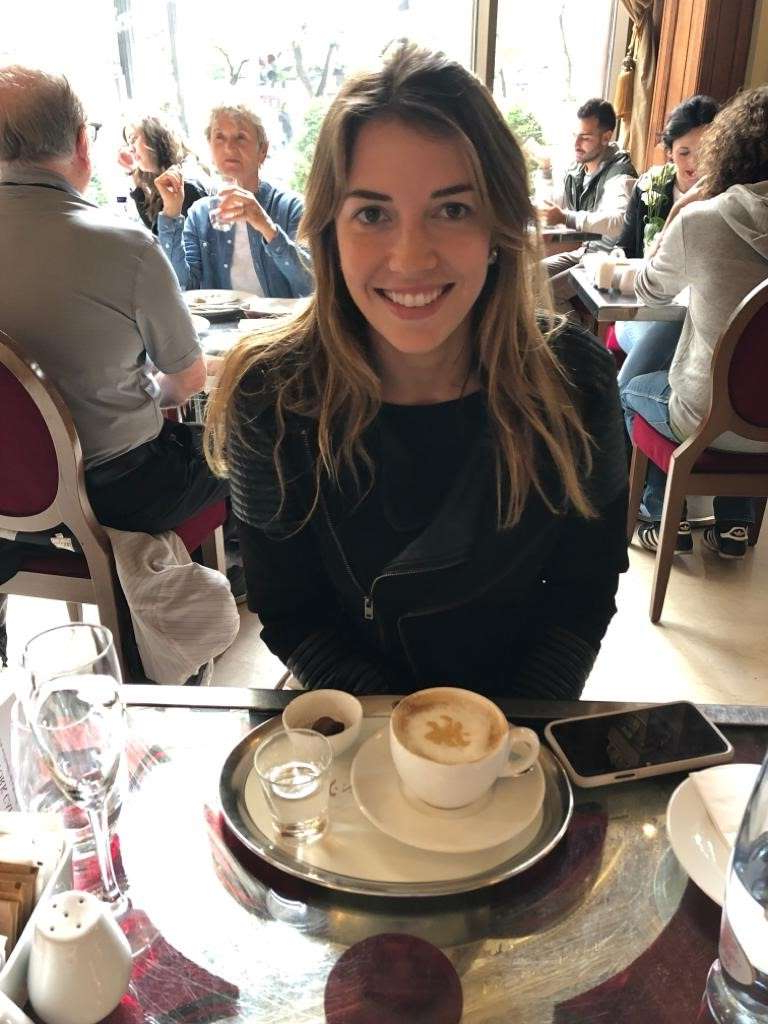 a woman sitting at a table in a restaurant: Caroline, who is from Brazil byt lives in Sydney, had been on holiday in Europe with partner, Johan.