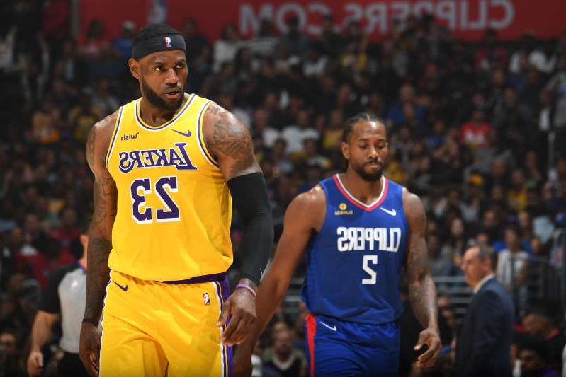 LOS ANGELES, CA - OCTOBER 22: LeBron James #23 of the Los Angeles Lakers looks on against the LA Clippers  on October 22, 2019 at STAPLES Center in Los Angeles, California. NOTE TO USER: User expressly acknowledges and agrees that, by downloading and/or using this Photograph, user is consenting to the terms and conditions of the Getty Images License Agreement. Mandatory Copyright Notice: Copyright 2019 NBAE (Photo by Andrew D. Bernstein/NBAE via Getty Images)