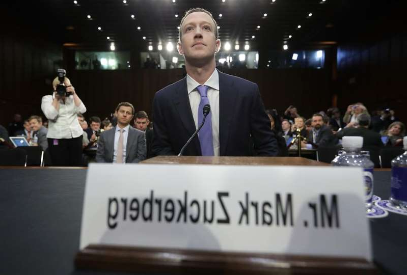Mark Zuckerberg wearing a suit and tie: Facebook CEO Mark Zuckerberg returns to Washington on Wednesday to face questions about his company's cryptocurrency effort, Libra. Chip Somodevilla/Getty Images