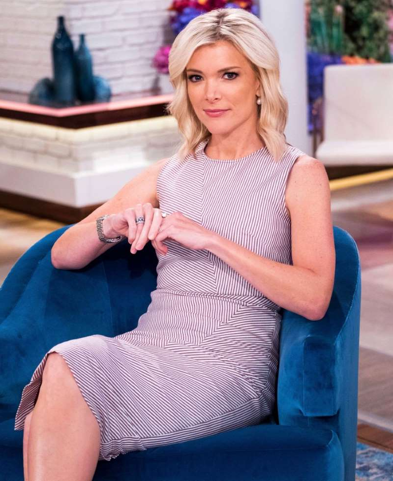 Megyn Kelly sitting on a blue dress: Megyn Kelly on the set of her new show