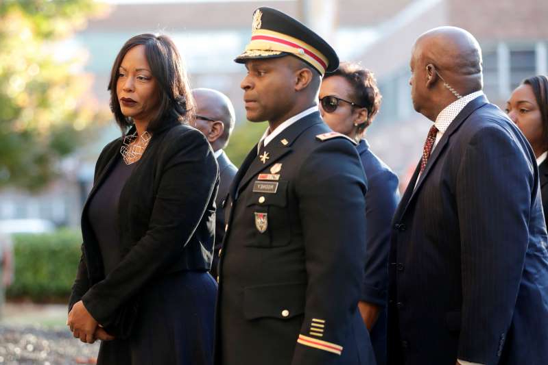 Mourners, including Maya Rockeymoore, right, widow of U.S. Rep. Elijah Cummings follow behind pallbearers walking with the congressman's body while arriving at Morgan State University ahead of a public viewing, Wednesday, Oct. 23, 2019, in Baltimore. (AP Photo/Julio Cortez): Mourners, including Maya Rockeymoore, right, widow of U.S. Rep. Elijah Cummings, follow behind pallbearers walking with the congressman's body while arriving at Morgan State University ahead of a public viewing on Oct. 23, 2019, in Baltimore.